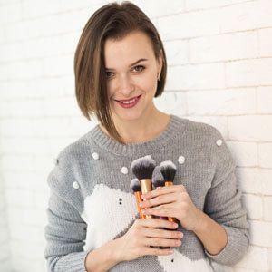 Girl with makeup brush kit